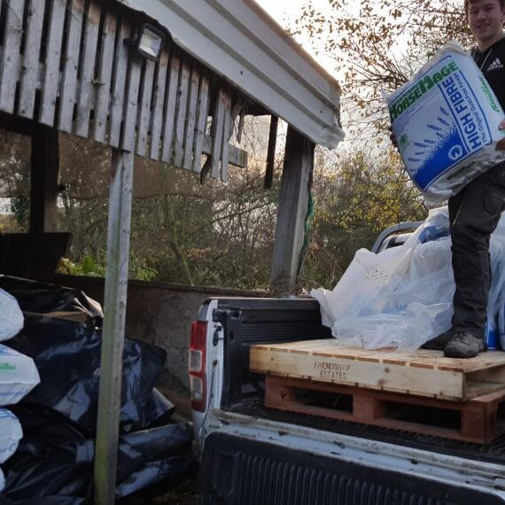Jon-Paul helping unload HorseHage and Mollichaff for flooded village.